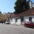 Paved stone of street of old city with cars and people — Stock video #32349455