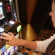 Woman presses buttons of slot machine, loses and frowns close up — Stock Video