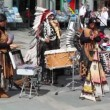Few indians in national costumes play music on street — Stock Video #32349461