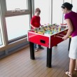 Little boy plays table football with mother — Vídeo Stock