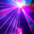 Stock Video: Multi-colored laser beams move in dark proceeding from one point