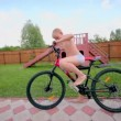 Boy in underpants ride on bike by road at homestead — Vídeo de stock