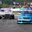 Racing cars enter into turn in front of tribunes with audience — Stock Video #32349705