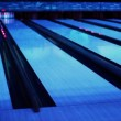 Ball thrundles in flume near bowling lane at dark club — Stock Video