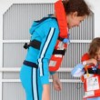 Stock Video: Mother helps daughter to fasten rope of life jacket on ship deck