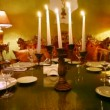 Tableware stands on table on which light candles in restaurant — Stock Video