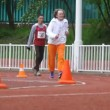 Runners overcome turn on Olympic center. — Stock Video #32349895