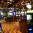Game hall of empty casino with working slot machines — Stock Video