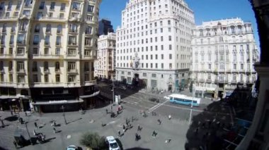 People walk on Gran Via Street and Montera Street near café — Stock Video