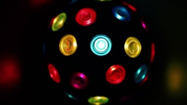 Automatic electric light sphere spins with colors heliofilters — Stock Video