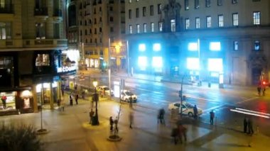 People walk on Gran Via Street near cafe of McDonald at night — Stock Video