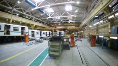 New white carriages of train stand in assembly shop of plant — Stock Video