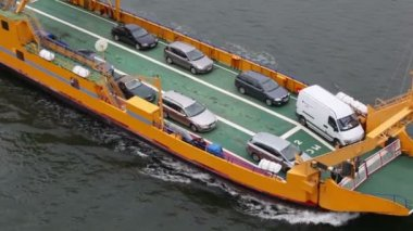 Automobiles and passengers on deck of ferry boat float in sea — Stock Video