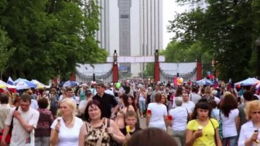 MOSCOW - MAY 25: Many people walk through gate in park at summer day on Sokolniki May 25, 2011 in Moscow, Russia