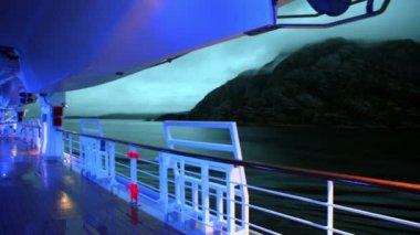 Illumination on deck of ship which floats near coastline — Stock Video