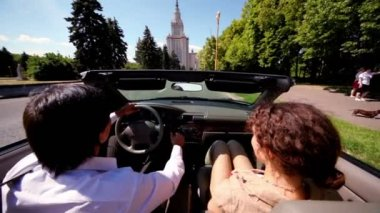 Couple start moves in cabriolet on road at day — Vídeo de Stock