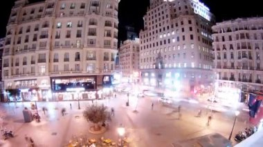 People walk on Gran Via Street and Montera Street in evening — Stock Video