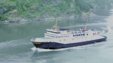 Passengers ship with tourists on deck float in fiord — Stock Video