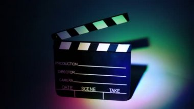 Film slapstick with some information on it in color illumination — Stock Video