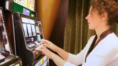 Woman presses buttons on slot machine and rejoices to prize — Stock Video