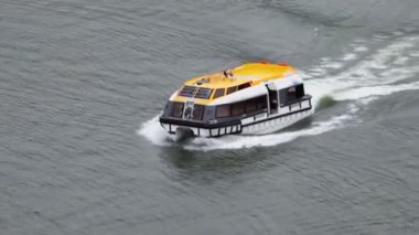 Motorized life-saving boat floats by water surface at day — Stok video