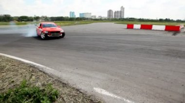 Cars rush on racing route against city landscape — Stock Video