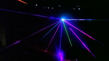 Laser show from multi-colored rays of light in dark in disco — Stock Video