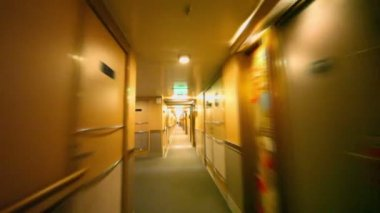 Motion through corridor with doors and lanterns on wall at ship — Stok video