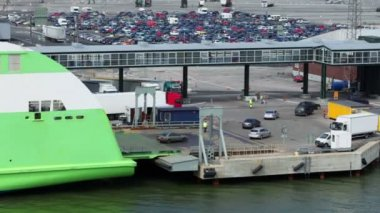 Cars ride from ferry boat in dock with huge parking — Stock Video