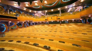 Empty theater with rows of yellow sofas, around motion — Stock Video