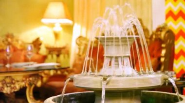 Luxury interior design supplements fountain in restaurant hall — Stock Video
