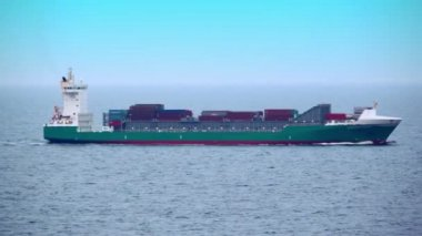 Barge floats in ocean with many containers on deck — Stock Video