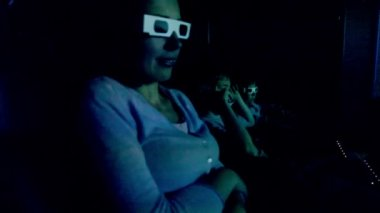 Family in 3d stereo glasses sit at cinema and watch movie — Stock Video