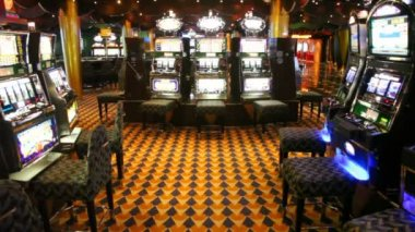 Empty hall with slot machines which were shone everywhere — Stock Video