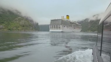 Back side of rescue boat which float to huge cruiser on fiord — Stock Video
