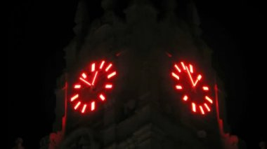 Clock hands are shone in dark on tower, time lapse — Stock Video