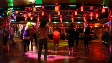 Women dance on dance floor under music and multi-colored fires — Stock Video