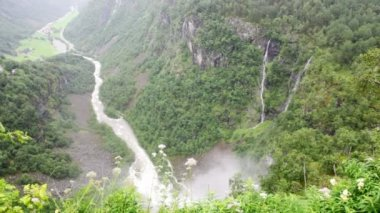 Mountains with falls, fiord and small houses in valley below — Stock Video