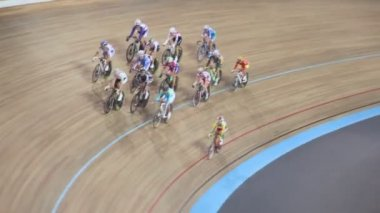 Group of bicyclists ride by track, shown in motion — Stock Video