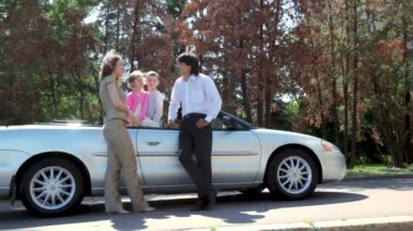 Parents speak near cabriolet and kids listen them inside car — Stock Video