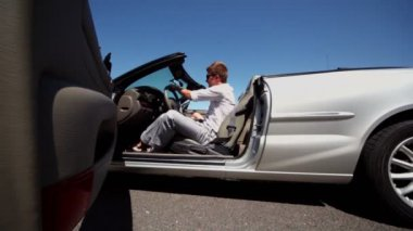 Boy and his girlfriend go out cabriolet at sunny day — Stock Video