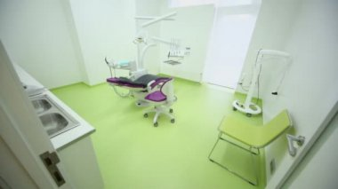 Dental surgery with tv set above medical equipment — Stock Video