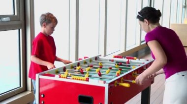 Mother plays table football with her son during cruise — ストックビデオ