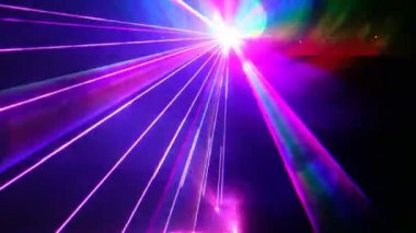 Multi-colored laser beams move in dark proceeding from one point — Stock Video