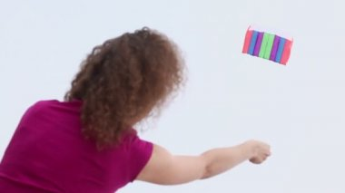 Woman flies kite and holds rope, view from behind at day — Stock Video