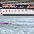 Two kayaks, yacht and rescue boat float on fiord near huge liner — Stock Video