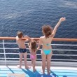 Mother, daughter and son stands waving hands on board ship — Stock Video