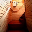 Instep by staircase in wooden house, shown in motion — Stock Video