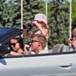 Students with kids sit in cabriolet girl looks through binocular — Stock Video
