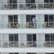 Stock Video: Worker closes partitions between balconies on cruiser